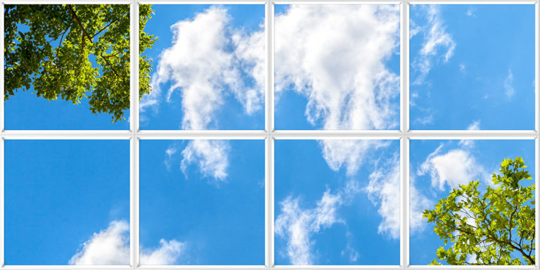 Fake window for office with sky, clouds and trees