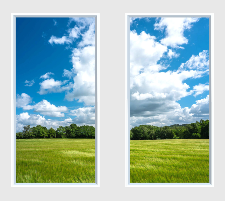 Side by side fake windows of the countryside under blue sky with clouds